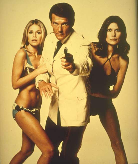 Roger Moore with Britt Ekland, left, as Mary Goodnight, with Maud Adams, right, as Andrea Anders in The Man With The Golden Gun in 1974