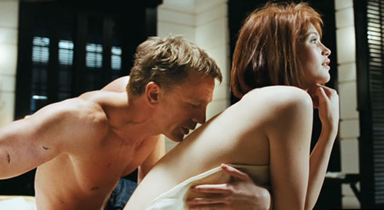 Daniel Craig as Bond with Gemma Arterton as Strawberry Fields in Quantum of Solace in 2008